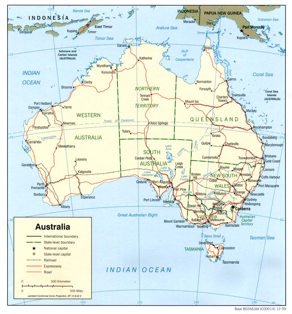 Australia map with state boundaries and their capitals, railroads, highways, roads and scale in kilometers and miles.